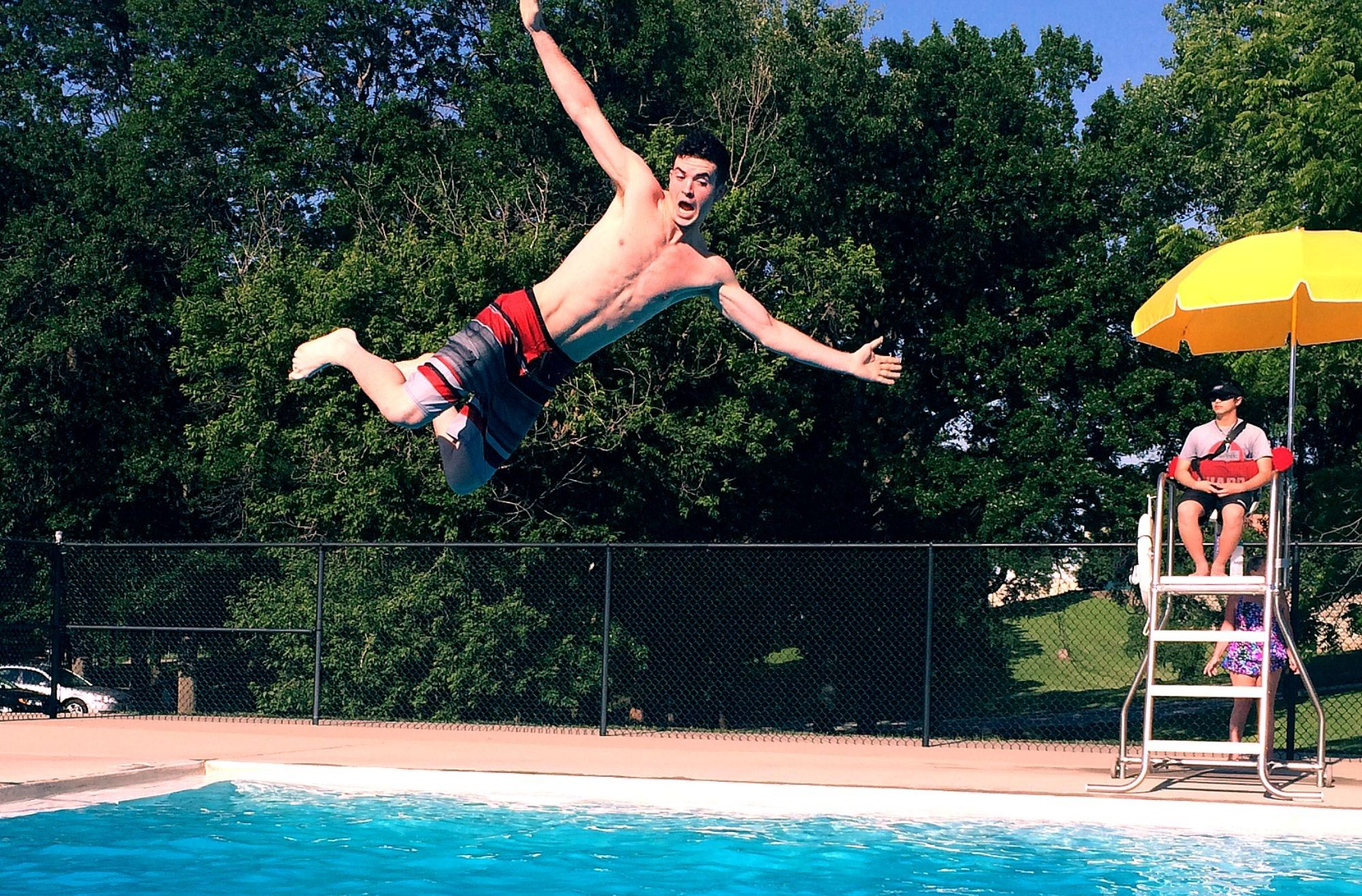 Nassif Pool Adult Male Jumping In